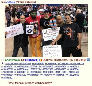 Q Adherents at a Trump rally